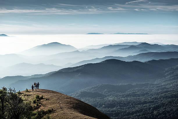 Trekkers standing on the hill, Monjong, Thailand stock photo