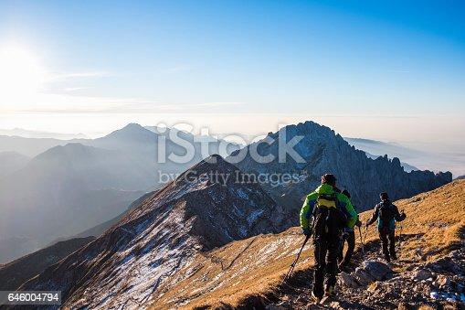 istock Trekkers walking on mountain up trail 646004794