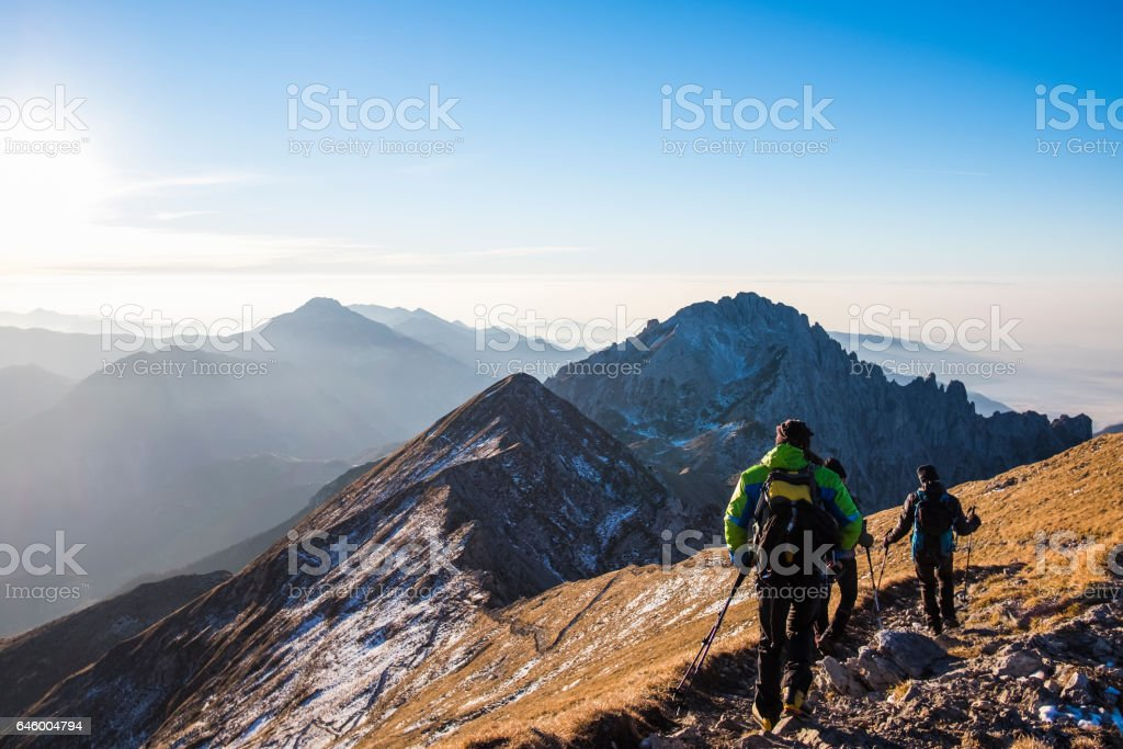Trekkers walking on mountain up trail stock photo