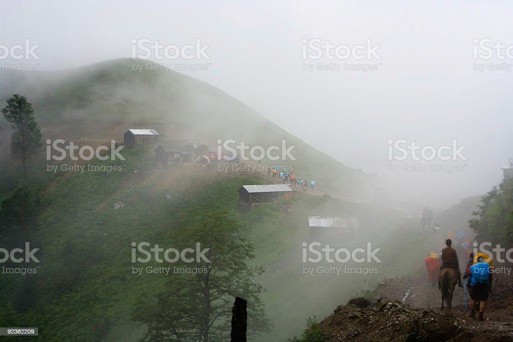 Trekkin in fog royalty-free stock photo