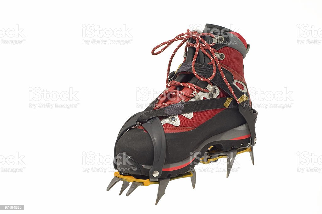 Trekking boot with crampons royalty-free stock photo