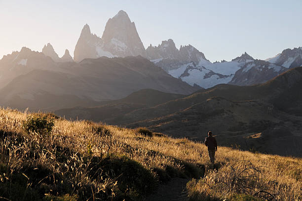 Trekking in El Chalten, Patagonia, Argentina, South America A man, sunset and Fitz Roy Mountain, El Chalten, Patagonia, Argentina, South America steppe stock pictures, royalty-free photos & images