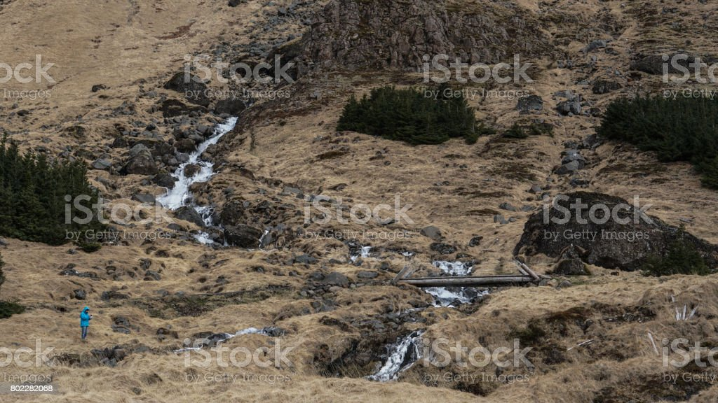Trekking man scale with majestic waterfall mountain size. How...