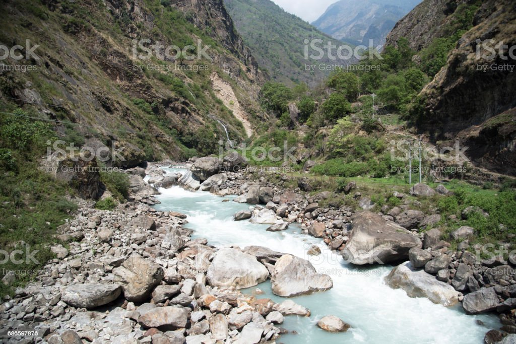 Trekking path beside a river along the Annapurna Circuit royalty-free stock photo