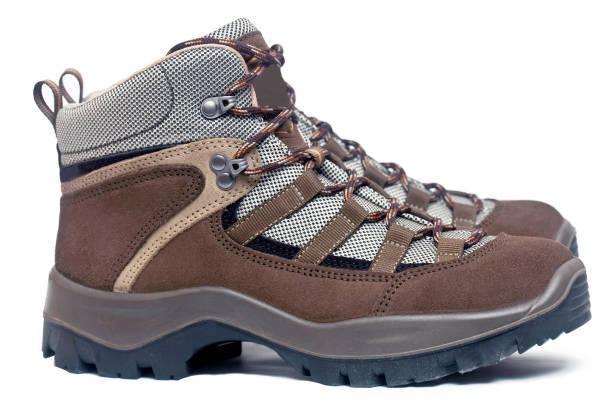 Trekking shoes on white background stock photo