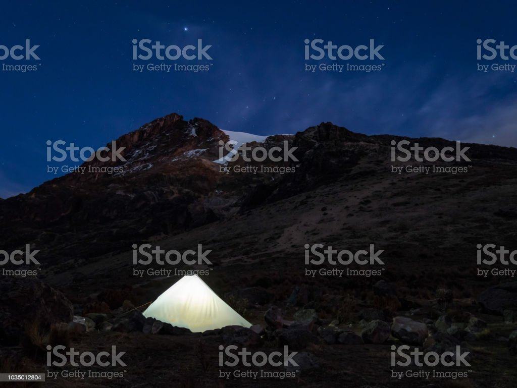 Trekking trip to summit of Nevado del Tolima Los Nevados National Park, basecamp at night with stars, Colombia stock photo