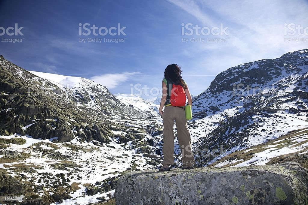 trekking woman at a snow valley royalty-free stock photo
