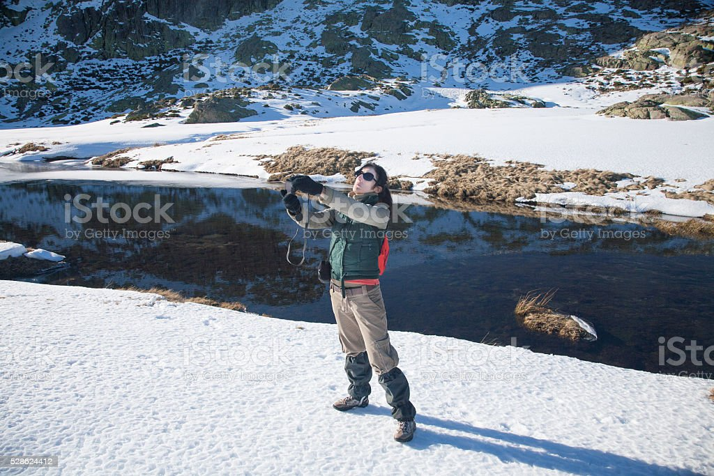 trekking woman photographing selfie stock photo