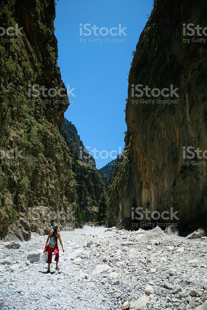 trekking woman walking in Samaria Gorge Crete stock photo