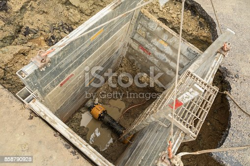 This box made of aluminum or steel is used for protection underground while utility workers do their job. This is a water main repair site below a section of damaged road.