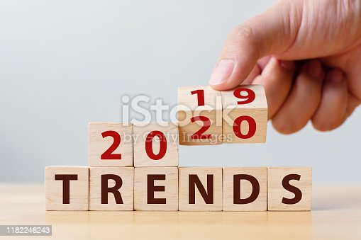 istock 2020 trend concept. Hand flip wood cube change year 2019 to 2020 1182246243