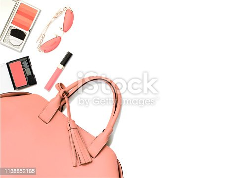 1078252326 istock photo Trend photography on the theme of the new color of the year 2019 - Living Coral.  Woman's handbag and accessories on white background, copy space 1138852165