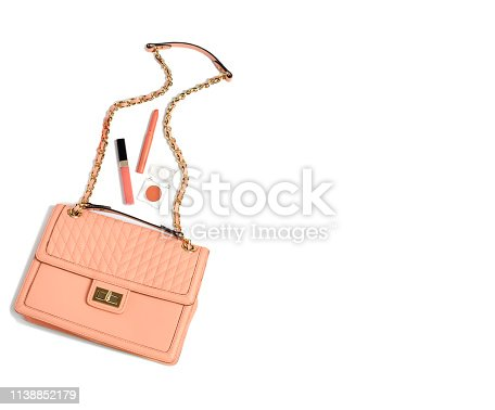 1078252566 istock photo Trend photography on the theme of the new color of the year 2019 - Living Coral. Women's set of fashion accessories color on white background. 1138852179