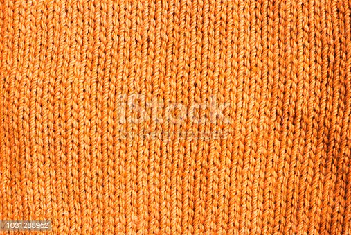 trend russet orange woolen knitted background, texture, close-up