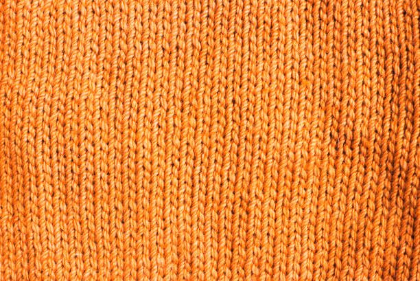 trend russet orange woolen knitted background, texture, close-up stock photo