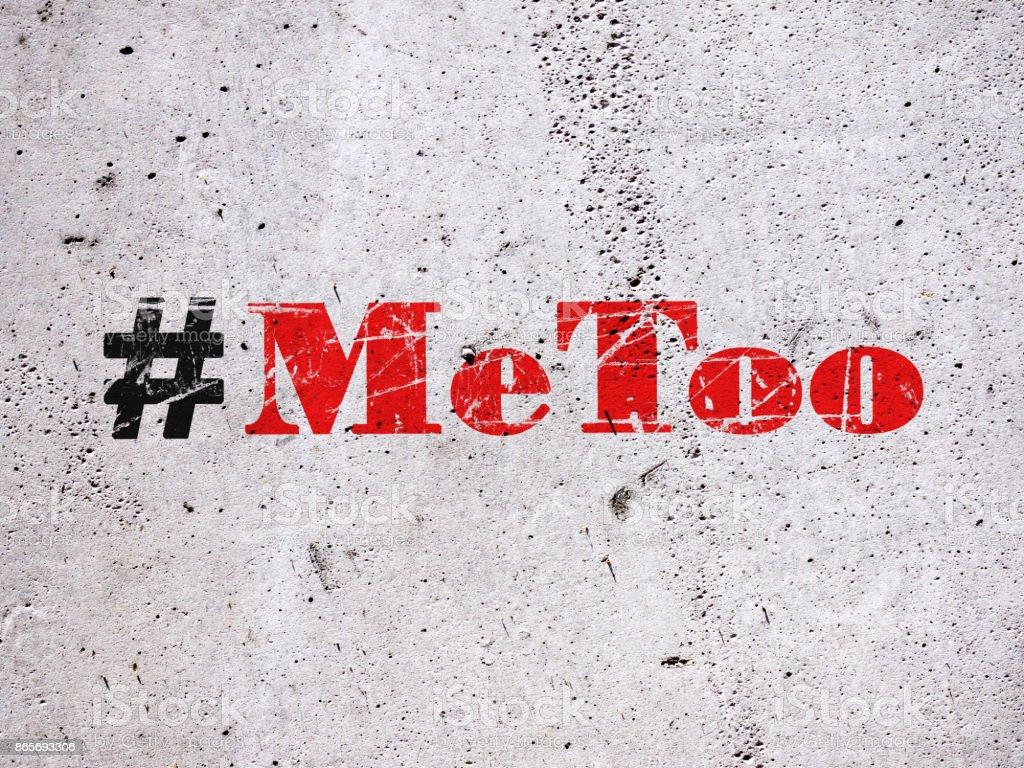Trending hashtag Metoo on concrete wall stock photo