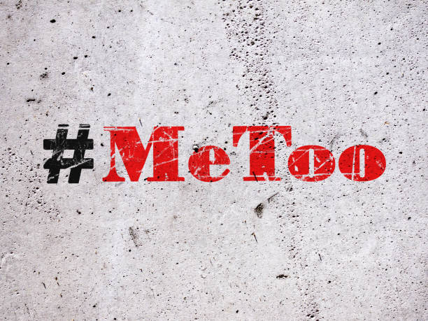 trending hashtag metoo on concrete wall - rubber stamp texture stock photos and pictures