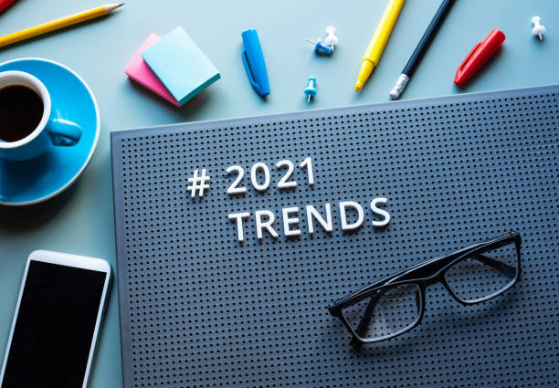 2021 trends and business vision concepts with text on modern desk.communication plan. stock photo