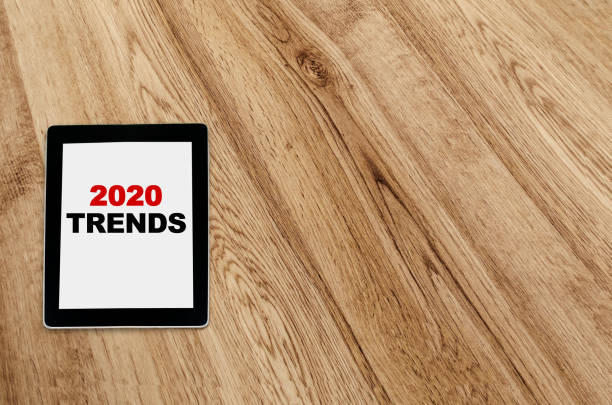 2020 trends written on tablet screen stock photo