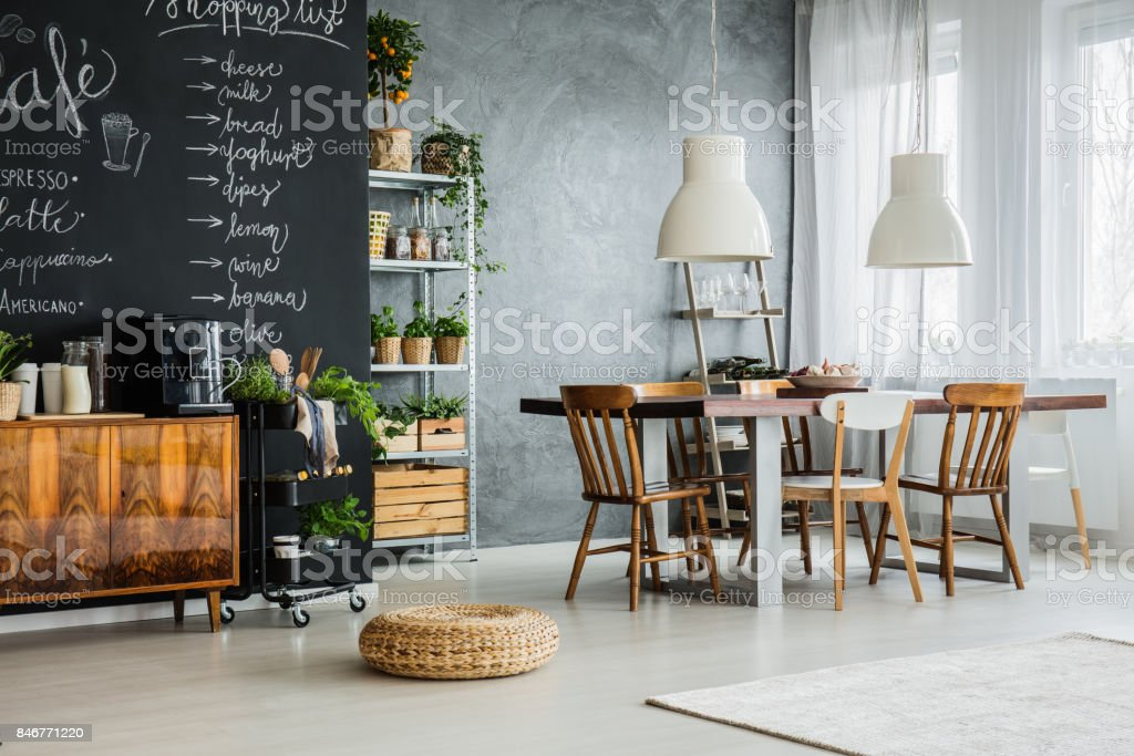 Trendy apartment with chalkboard wall stock photo