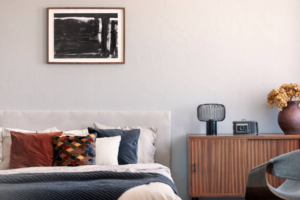 Trendy bedroom with comfortable king size bed in modern flat, real photo stock photo