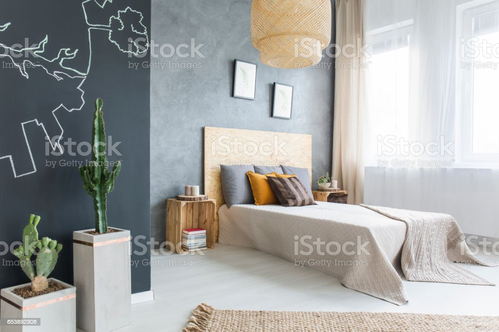 Trendy bedroom with double bed stock photo