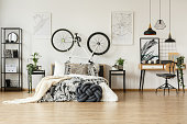 Trendy bedroom with patterned decorations