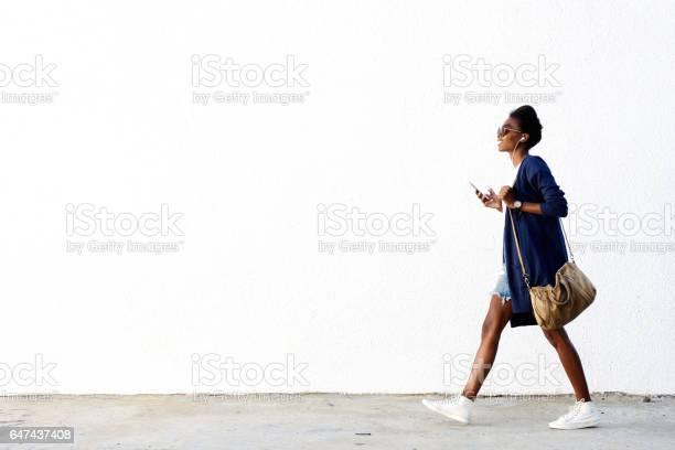 Trendy black woman listening music on mobile phone picture id647437408?b=1&k=6&m=647437408&s=612x612&h=flj5f  36r 8rioivbed9vbp  vti2b6haiz78dx ga=