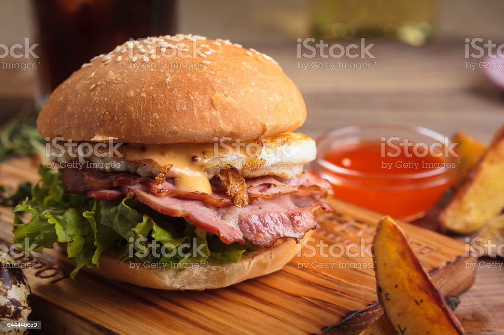 Trendy breakfast burger with ham and eggs stock photo