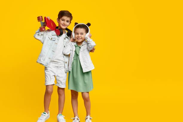 Trendy children listening to music stock photo