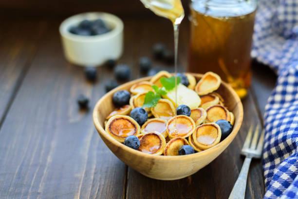 Trendy comfort food - pancakes cereal in bowl