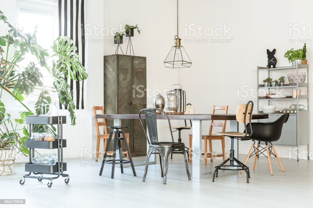 Trendy dining room with table stock photo