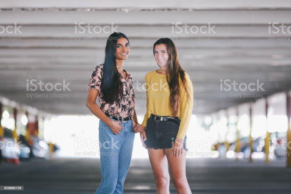 Trendy diverse teenage friends stock photo