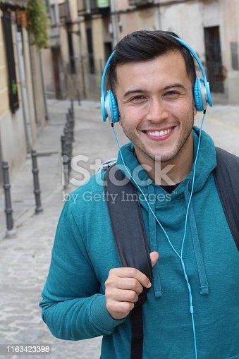 istock Trendy ethnic student heading to the university 1163423398