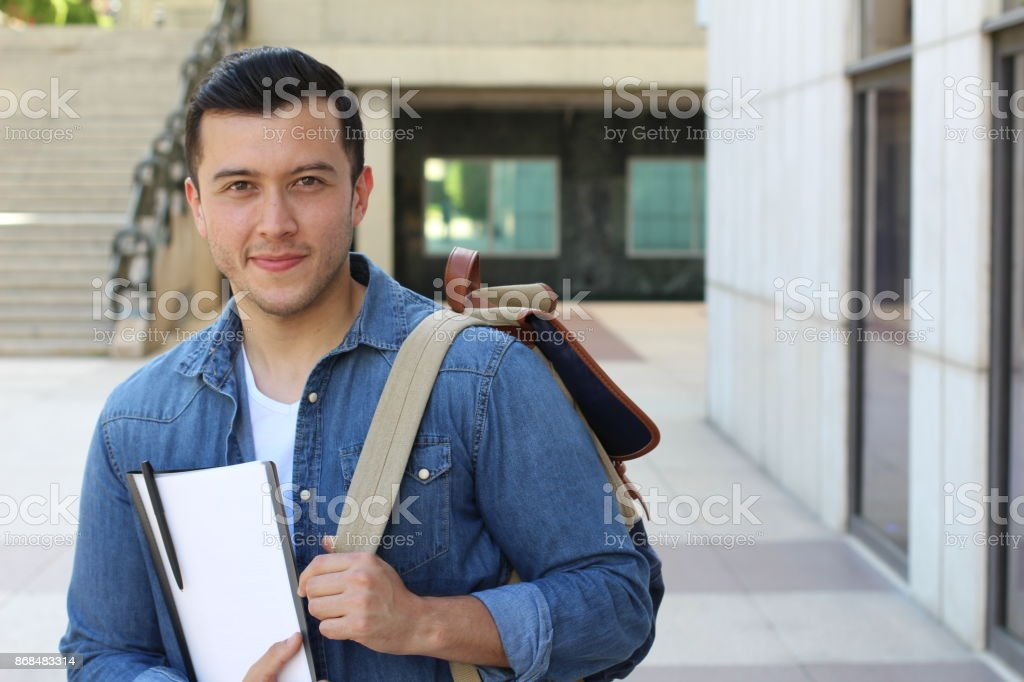 Trendy ethnic student heading to the university stock photo