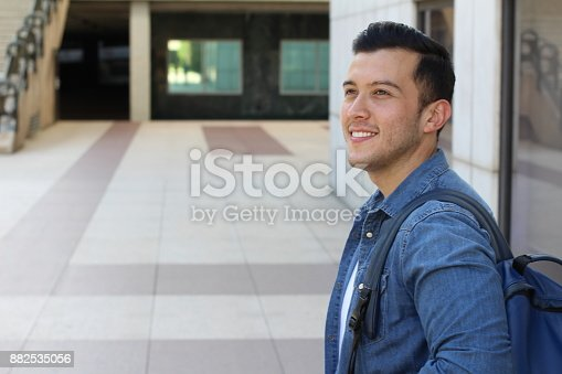 istock Trendy ethnic student heading to the university 882535056