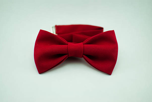 Trendy fashionable red bow tie; isolated Stylish and well-designed red bow-tie on a white background; isolated bow tie stock pictures, royalty-free photos & images