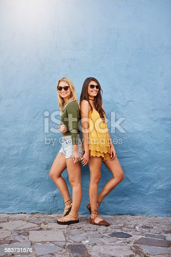 istock Trendy female friends in stylish outfits 583731576