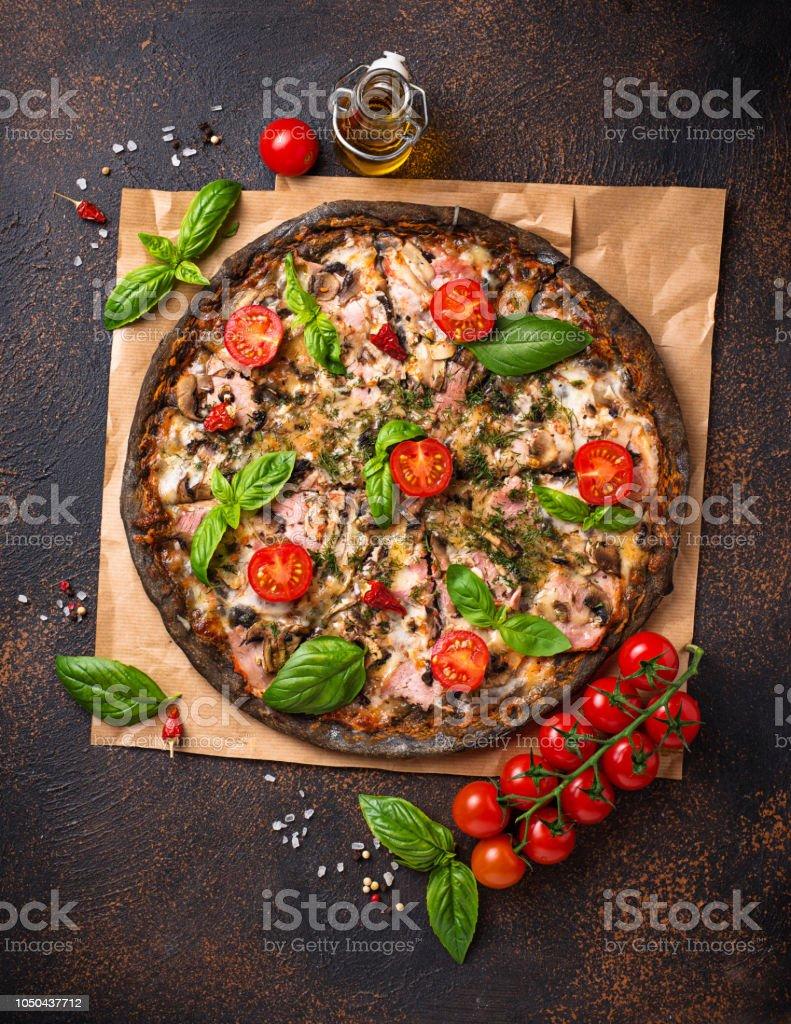 Trendy food Italian black pizza royalty-free stock photo