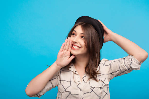 trendy girl gossiping on blue background - moldova stock pictures, royalty-free photos & images