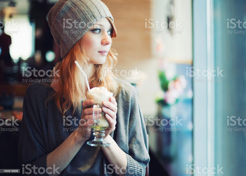 Trendy girl in a cafe royalty-free stock photo