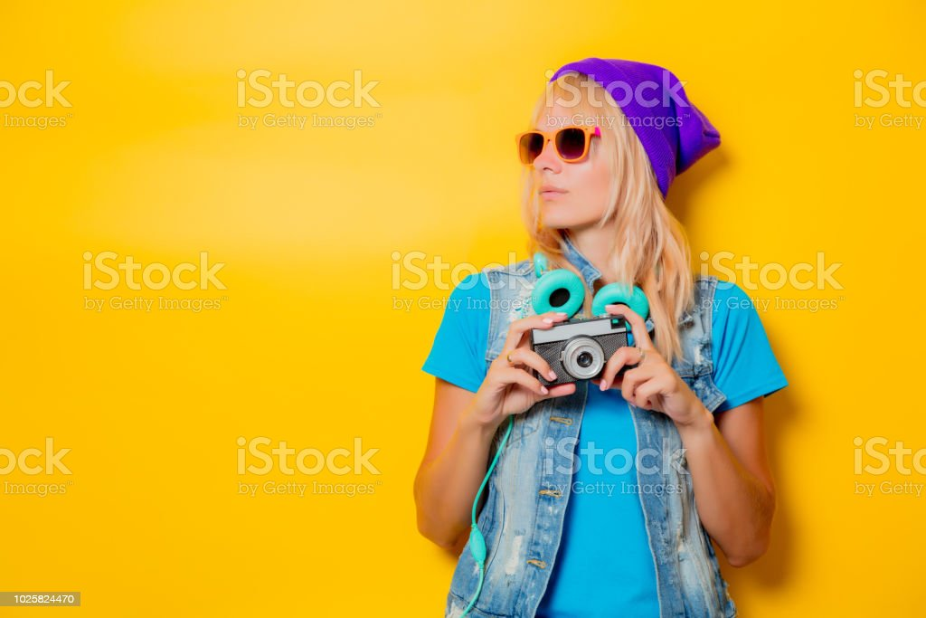 trendy girl in hat with camera stock photo