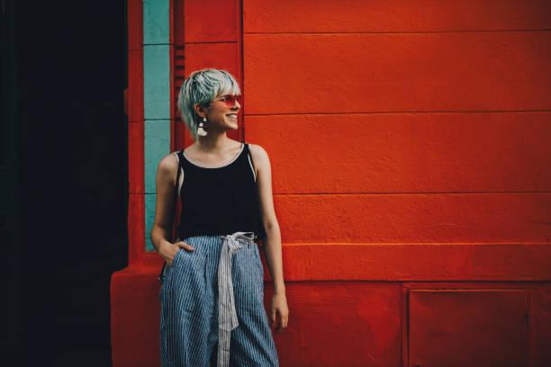 trendy girl posing against a wall in buenos aires - showus стоковые фото и изображения