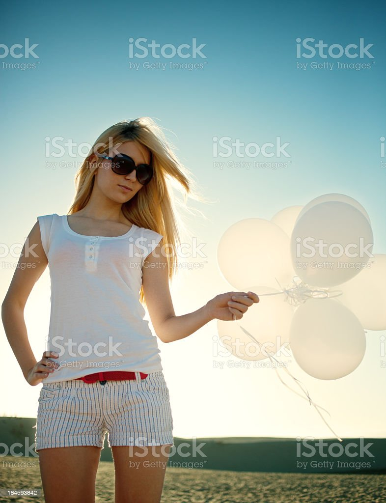 Trendy girl with balloons royalty-free stock photo