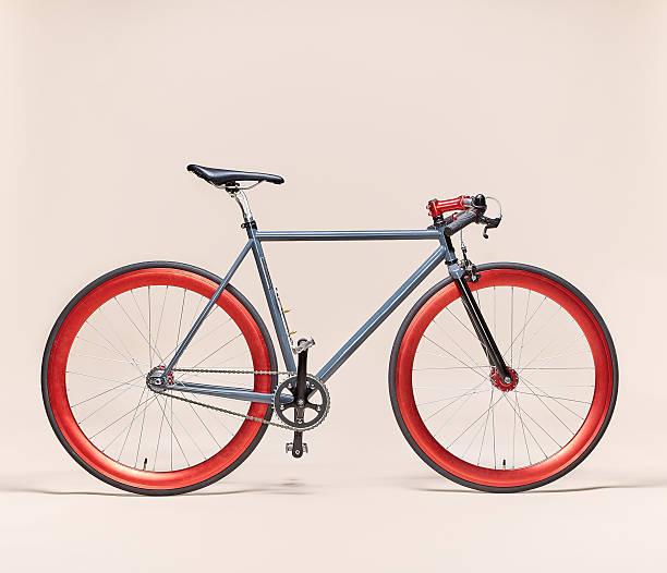 trendy grey and red bicycle - bastidor de la bicicleta fotografías e imágenes de stock