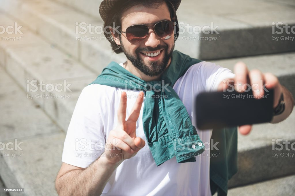 Trendy guy making funny selfie - Royalty-free Adult Stock Photo