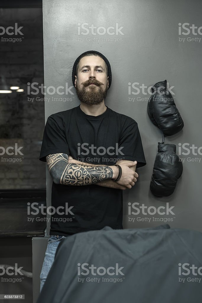 Trendy hairdresser in barbershop stock photo