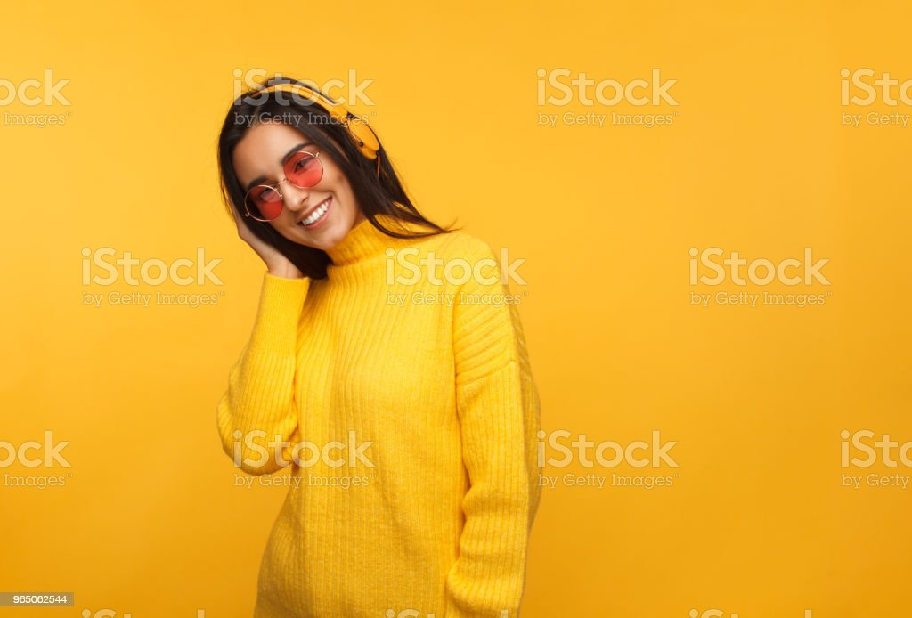 Trendy hipster girl in headphones royalty-free stock photo