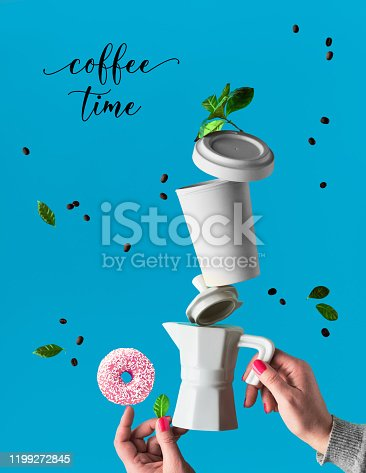 Trendy levitation. Flying line of coffee beans between ceramic coffee maker and espresso cup with saucer. Pink doughnuts with sugar sprinkles balance on finger. Blue mint background with palm leaves.