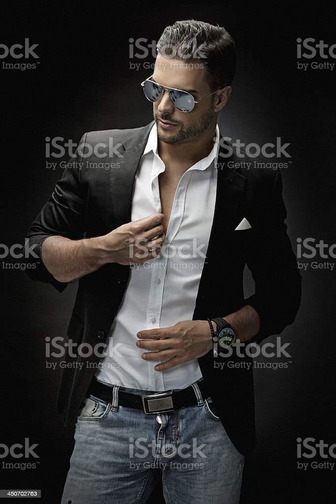 trendy male model wearing sunglasses stock photo